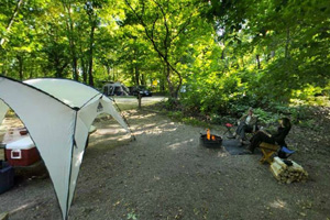 Photo of visitors relaxing at one of the popular non-electric campsites.
