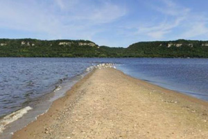 Photo of a sandy point that extends into Lake Pepin and changes shape with fluctuating water levels.