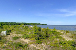 Photo of the summer shore view from a shelter that provides escape the winter wind, used by winter snowmobile trail riders.