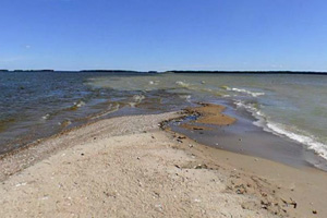 Photo of a sand spit, which is important to migrating shore birds.