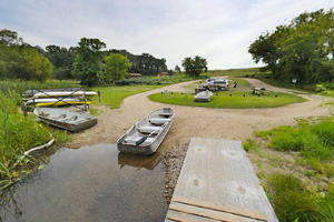 Photo of the boat launch area where rental equipment can be found for visitors to enjoy the lake.