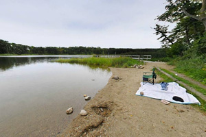 Photo of the beach on spring-fed Signalness Lake, allowing swimming all summer.