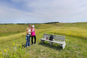 Photo of visitors enjoying open plains and rolling hills within the park.