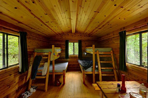 Photo of the rustic, but charming interior of a camper cabin.