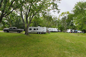Photo of a portion of the Lower Campground with trailers using several sites.