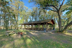 Photo of the covered picnic shelter on Molly Stark Lake at Glendalough.