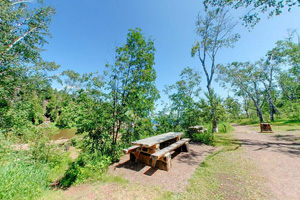 Photo of a stone picnic table at Gooseberry Falls State Park.