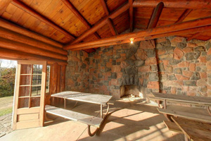 Photo of the interior of the reserveable log and stone Lakeview Shelter at Gooseberry Falls State Park.