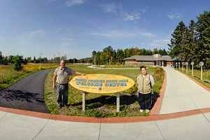 Photo of the park staff at the Grand Portage State Park welcome center, welcoming travelers to the Grand Portage area.