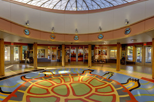 Photo of the lobby of the welcome center featuring a turtle motif on the floor that illustrate the Ojibwe creation and migration stories.