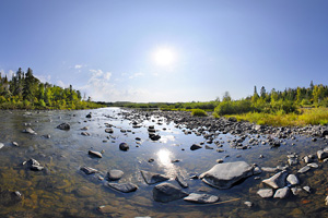 Photo of a view of the rocky Pigeon River shoreline.