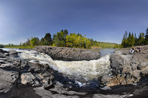 Photo of river bedrock visible along the Middle Falls.