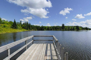 Photo of an accessible wooden fishing pier located in the park.