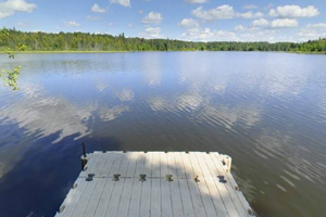 Photo of a floating dock that's accessed from the campground by a series of wooden stairs.