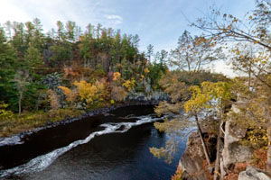 Photo of the St. Croix river valley, with a hint of fall leaf color.