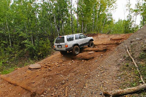 Photo of a driver traveling up the High Voltage Off Road Vehicle trail.