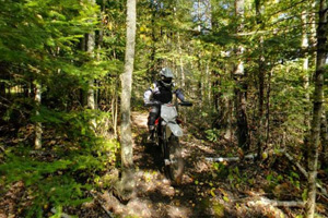 Photo of an off-highway motorcycle rider traveling on the Littlefoot Trail.