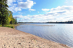 Photo of the swimming beach at Lake Itasca.