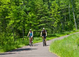 Photo of a pair of bicycle riders on the trail.
