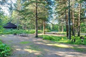 Photo of wooded campground and park facilities.