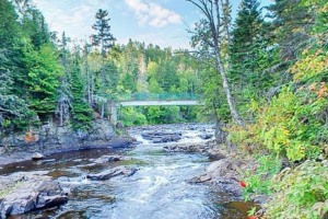 Photo of the rocky outcrops of Brule River rapids.