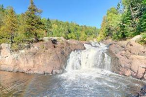 Photo of the Brule River's upper falls cascading downstream.