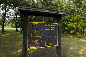 Photo of the nature trail sign within Kilen Woods State Park.