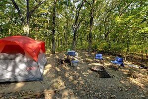 Photo of  campers enjoying a rustic camping experience.