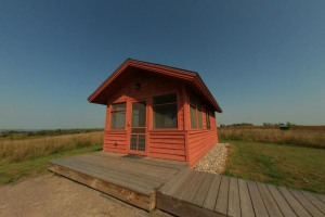Photo of the hill prairie camper cabin with a lakeside view.