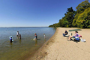 Photo of the long sandy shore of the swimming beach on Lake Bemidji.