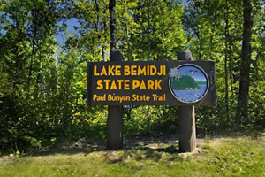 Photo of the park entrance, welcoming you to Lake Bemidji State Park, about 7 miles north of Bemidji,