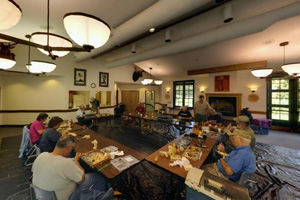 Photo of the great room within the visitor center, showing participants attending a Woodcarvers Festival.