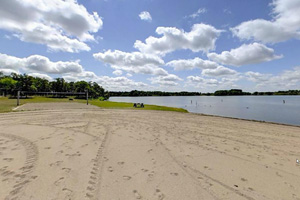 Photo of tracks in the park's large, sandy beach, on a sunny day.