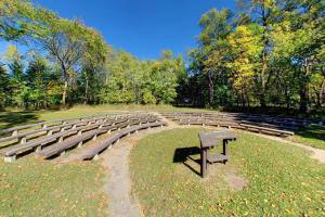 Photo of the park amphitheatre seating and grassy stage.