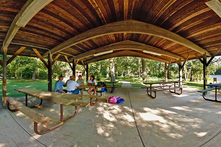 Photo of the large wooden beams in the interior of the park's picnic shelter.