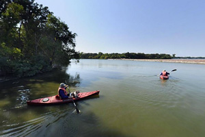 Photo of the park's boat landing, a place to rent row boats, canoes, kayaks, or stand-up paddleboards.