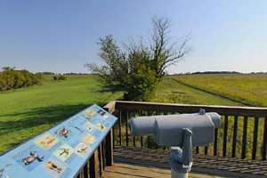 Photo of an observation deck with views of Eastlick Marsh and the surrounding prairie.