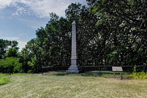 Photo of a stone monument to settlers killed during the U.S.-Dakota War of 1862.