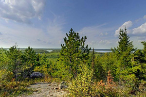 Photo of a rocky overlook offering a stunning blue and green vista of Lake Vermilion.