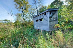 Photo of a rustic wildlife blind on Beaver Lake at Maplewood State Park.