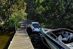 Photo of truck and boat trailer activity at the Sturgeon Lake Boat Access.