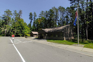 Photo of the park office entrance road, where visitors purchase vehicle permits or register to camp.