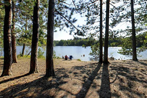 Photo of the rustic campground situated on a peninsula jutting out into Beatrice Lake.