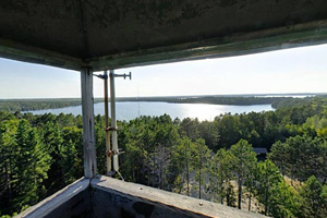 Photo of the view from the top of a nearby fire tower, where Side Lake can be seen in the foreground, with Sturgeon Lake visible behind.