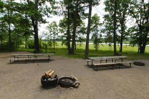 Photo of picnic tables the rustic group camp near the Rum River access.