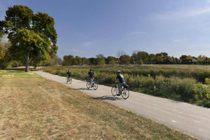 Photo of bikers using the trail within the park near the boat landing.