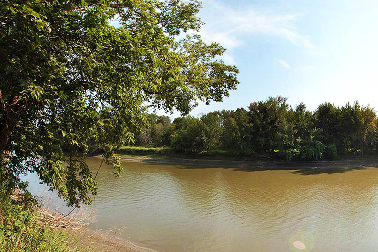 Photo of the location of a once a thriving riverboat stop, called West Newton, located below the Harkin Store.