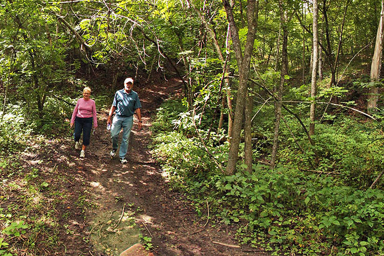 Photo of visitors enjoying a hike on the Lower Sioux Agency Hiking Trail.