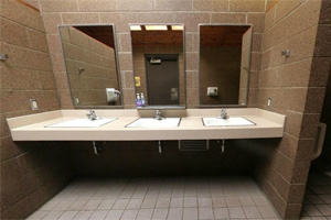 Photo showing the restroom sinks inside the restroom building.