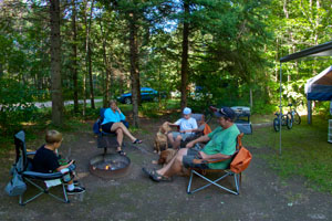 Photo of campers relaxing at Lake Shumway Campground.